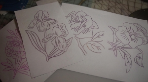 flowers traced with red iron on transfer pencil